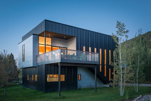 jackson hole area home features exterior rock climbing wall cache creek residence carney logan burke architects 007