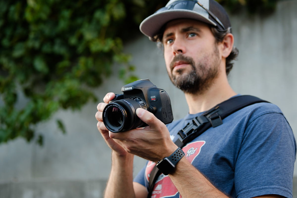 Canon EOS Rebel T8i product photo in hand