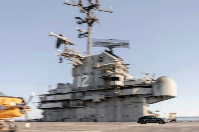 porsche taycan electric car acceleration test on aircraft carrier deck prototype