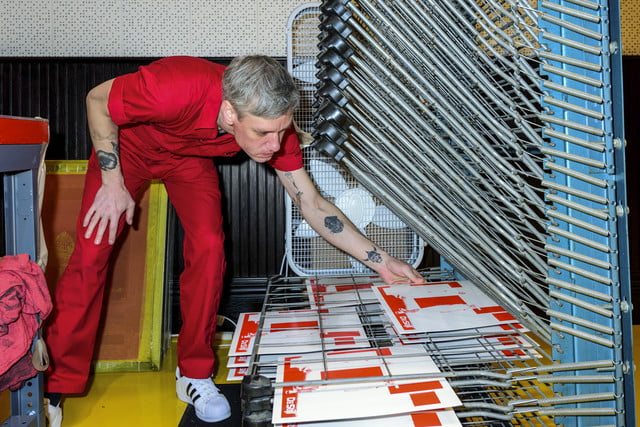 man-placing-new-covers-on-to-drying-rack