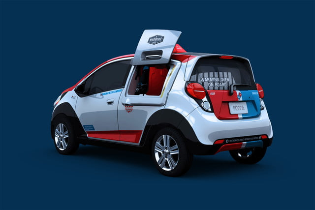 dominos innovative dxp chevrolet spark pizza delivery car 7