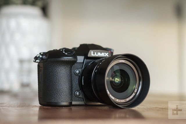 Panasonic Lumix G9 Review | Hero shot of the camera on a table facing the left side of the frame