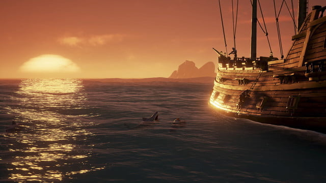 Sea Of Thieves Hands-on Preview | Backside of ship at sunset with a shark about to eat something