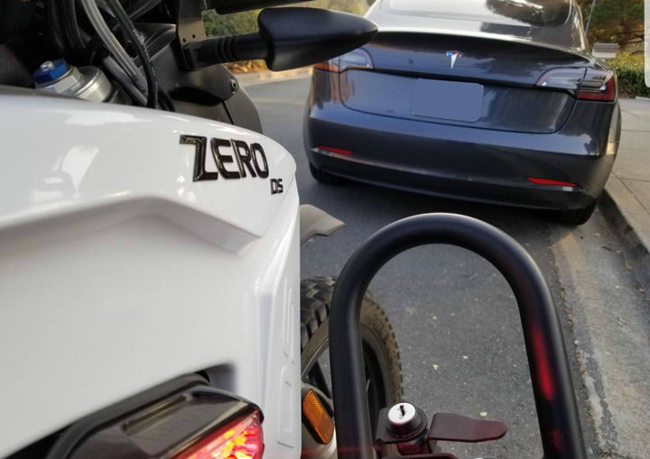 zero electric police motorcycle stops tesla model 3 pulled over a